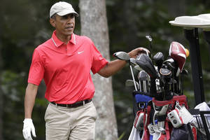 Obama escapes Washington for golf with Jeter in Vegas